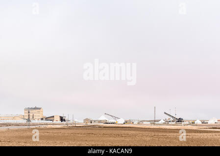 WALVIS BAY, NAMIBIA - JULY 1, 2017: A salt processing plant at Walvis Bay in the Namib Desert on the Atlantic Coast - Stock Photo