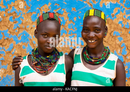 Hamer tribe young girls, Dimeka, Omo valley, Ethiopia - Stock Photo