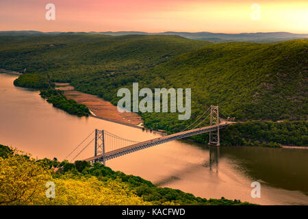 Aerial view of Bear Mountain Bridge at sunrise. Bear Mountain Bridge is a toll suspension bridge in New York State, - Stock Photo