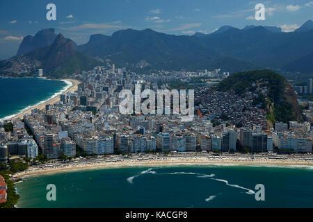 Ipanema Beach (top left), people on Copacabana Beach, apartments, and Cantagalo Favela (at right), Rio de Janeiro, - Stock Photo
