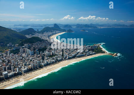 People on Ipanema Beach, and Copacabana Beach (top), Rio de Janeiro, Brazil, South America - aerial - Stock Photo