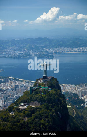 Christ the Redeemer statue atop Corcovado, and Guanabara Bay, Rio de Janeiro, Brazil, South America - aerial - Stock Photo