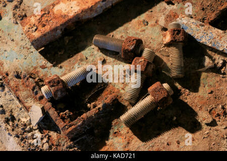 Nuts and bolts rust on floor of E B Eddy paper mill, Ottawa, Canada, closed in 2007. - Stock Photo