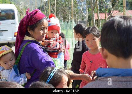 Ha Giang, Vietnam - November 08, 2018: Unidentified group of children wearing Hmong traditional new year clothe, - Stock Photo