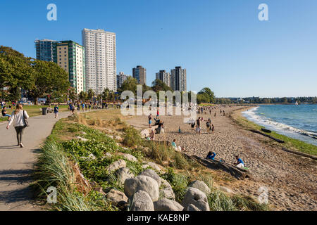 People enjoying a warm and sunny day at Vancouver English Bay beach in summer. Vancouver, British Columbia, Canada - Stock Photo