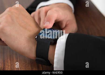 Close-up Of A Businessman Checking Time On Wrist Watch - Stock Photo