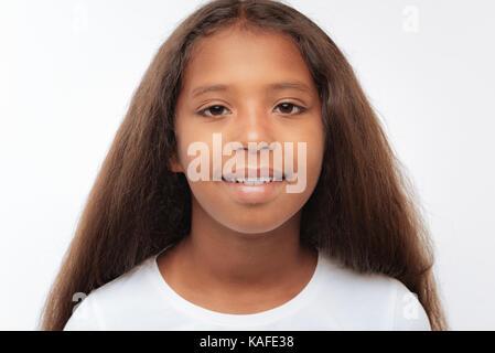Portrait of a pretty pre-teen girl with auburn hair - Stock Photo