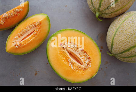 Fresh cantaloupe cut into pieces. - Stock Photo