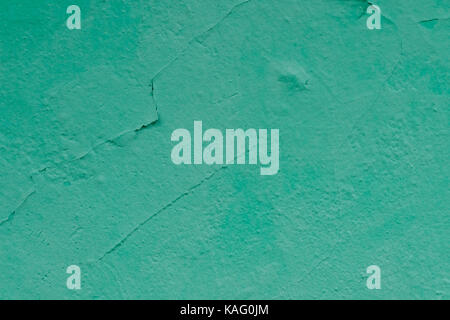 Wall with cracked paint mint color. - Stock Photo