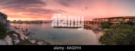 CAVALLO ISLAND, CORSICA - 18th SEPTEMBER 2017: Sun rising on 18th September 2017 over moored boats in the harbour - Stock Photo