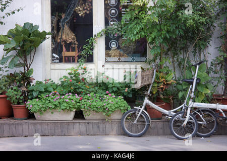 BEIJING, CHINA - SEP 21, 2017 : A coffee shop in Hutong alley at Beilouguxiang - Stock Photo