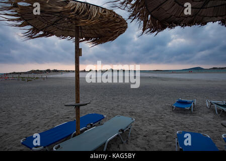 Elafonisi beach with palm ubmrellas in bad weather conditions - Stock Photo