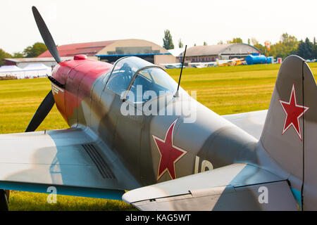 PRAGUE, CZECH REPUBLIC - 9.09.2017: Propeller military plane yak 52 parking at the airport in sunny day, Prague, - Stock Photo