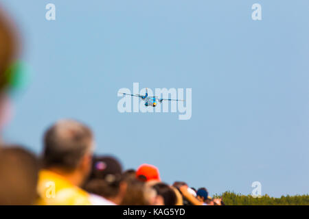 PRAGUE, CZECH REPUBLIC - 9.09.2017: People looking on Aircraft L 410 Turbolet in flight in blue sky at sunny day - Stock Photo