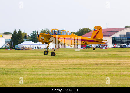 PRAGUE, CZECH REPUBLIC - 9.09.2017: One seat single engine yellow civil utility aircraft Cmelak in airport in Prague, - Stock Photo