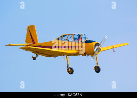PRAGUE, CZECH REPUBLIC - 9.09.2017: One seat single engine yellow civil utility aircraft Cmelak in blue sky in Prague, - Stock Photo