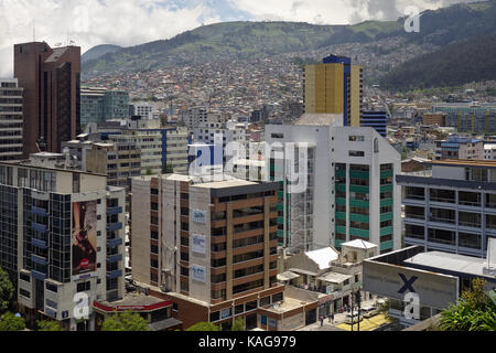 Quito, Ecuador - 2017: Office buildings in La Mariscal district with a residential neighbourhood in the background. - Stock Photo