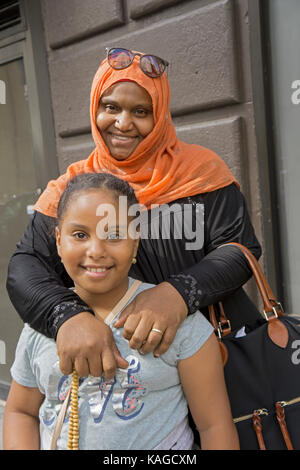 A mother from Sudan and her daughter at the Muslim Day Parade in Midtown Manhattan, New York City. - Stock Photo