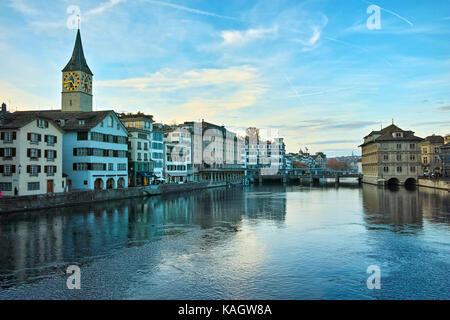 Sunset over city of Zurich and reflection in Limmat River, Switzerland - Stock Photo