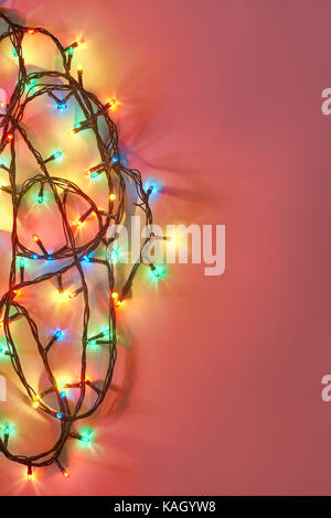 Christmas Lights On Dark Pink Background With Copy Space Decorative Garland