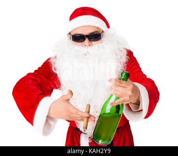Santa Claus wearing sunglasses holds a bottle of champagne and smoking a cigar isolated on white background - Stock Photo