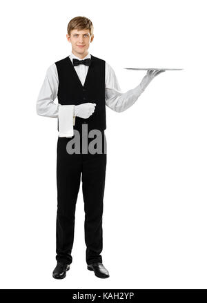 Full length portrait of handsome elegant waiter holding empty silver tray isolated on white background - Stock Photo