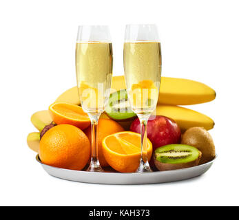 Two champagne glasses and ripe fruits plate isolated on white background - Stock Photo