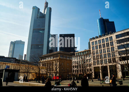 Frankfurt am Main, Germany - March 16, 2017: Goetheplatz with walking people, old buildings and modern skyscrapers - Stock Photo