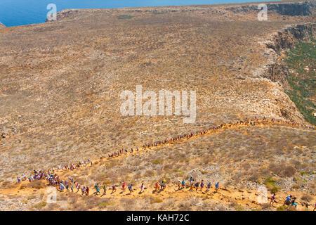 People climbing the hill on Gramvousa Island. Crete, Greece - Stock Photo