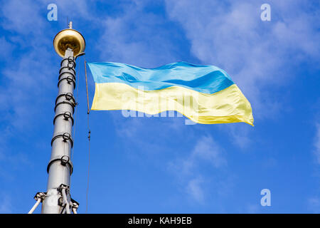 yellow-blue flag of Ukraine against the sky - Stock Photo