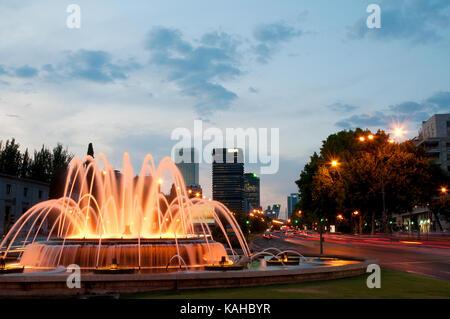 Fountain and Paseo de la Castellana, night view. Madrid, Spain. - Stock Photo