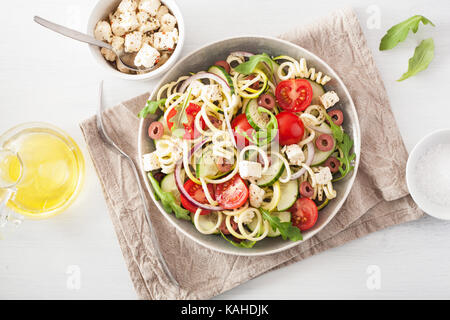 spiralized courgette salad greek style with tomato feta olives cucumber - Stock Photo