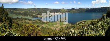 Panoramic view of the volcanic crater Caldeira das Sete Cidades and the volcanic lakes Lagoa Azul and Lagoa Verde - Stock Photo
