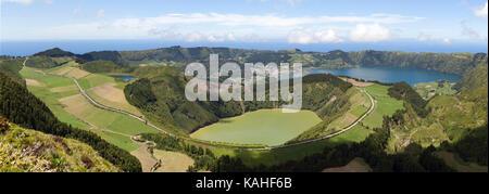 Panorama, view of the volcanic crater Caldeira das Sete Cidades, in front of the volcanic lake Lagoa de Santiago, - Stock Photo