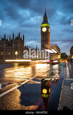 Traces of light, Double-decker bus in the evening, Westminster Bridge, Palace of Westminster, Houses of Parliament - Stock Photo