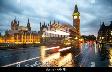 Traces of light, double-decker bus in the evening, Westminster Bridge, Palace of Westminster, Houses of Parliament, - Stock Photo