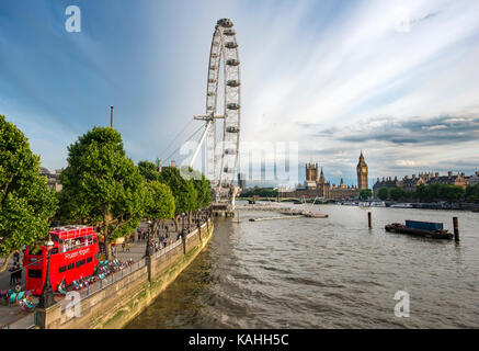 View over the Thames from Golden Jubilee Bridge, promenade with Ferris wheel London Eye, at the back Big Ben and - Stock Photo