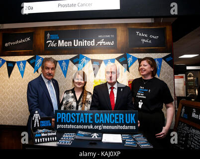 Brighton, Britain. 26th Sep, 2017. Labour Party's Shadow Chancellor John McDonnell (2nd R) poses with exhibitors - Stock Photo