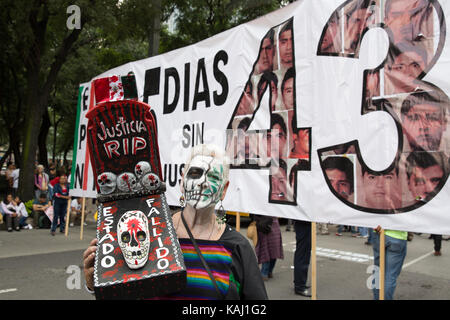 Mexico City, Mexico. 26th Sep, 2017. People march to mark the three-year anniversary of the disappearance of the - Stock Photo