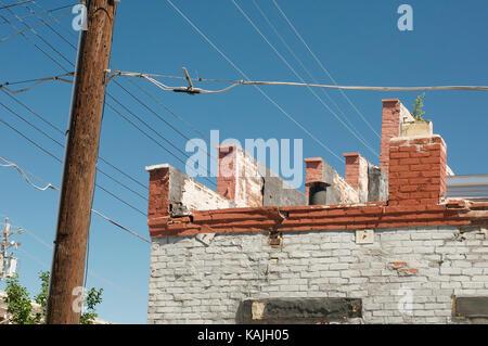 Brick built building with blue sky - Stock Photo