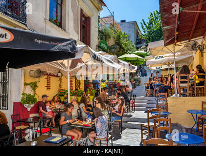 Cafes and tavernas on Mnisikleous Street in the Plaka district, Athens, Greece - Stock Photo
