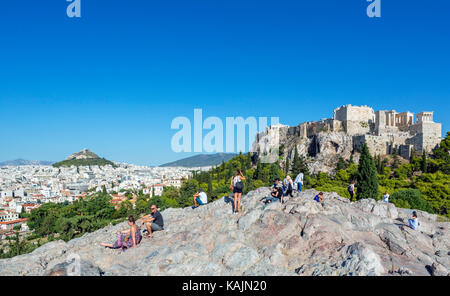 View of the Acropolis and the city from Areopagus Hill with Mount Lycabettus (Lykavittos Hill) in the distance, - Stock Photo