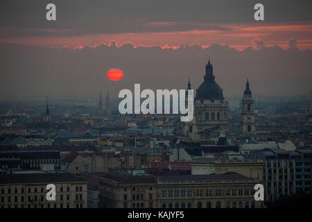 Budapest, Hungary - The famous Saint Stephen's Basilica with red sunrise in the city of Budapest - Stock Photo
