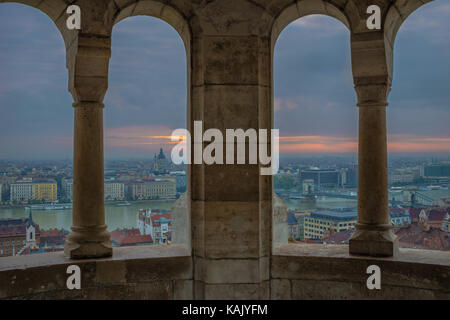 Budapest, Hungary - View from the Fisherman Bastion at sunrise with Szechenyi Chain Bridge and St.Stephen's Basilica - Stock Photo