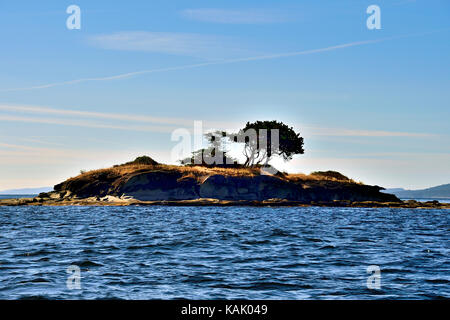 A small island in the Strait of Georiga near Vancouver Island British Columbia Canada. - Stock Photo
