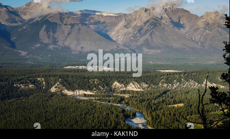 View over the Bow River winding its way through the valley, mountains in the background (Tunnel Mountain, Banff - Stock Photo