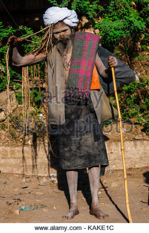 A sadhu walking along a road in Agra, Uttar Pradesh, India. - Stock Photo