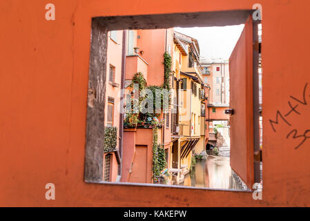 Window overlooking the Canale delle Moline in Bologna. It is one of the few stretches of the canals that is still - Stock Photo