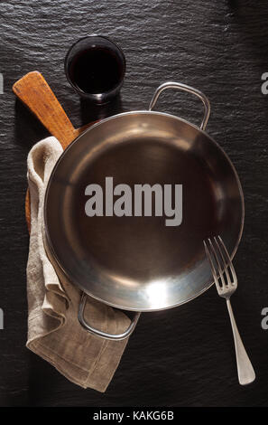 empty serving pan on Slate black stone background - Stock Photo