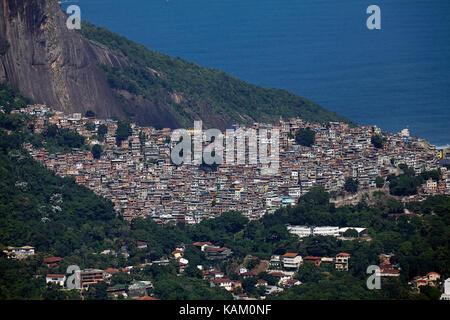 Rocinha favela (Brazil's largest favela), and Morro Dois Irmãos (rock hill), Rio de Janeiro, Brazil, South America - Stock Photo